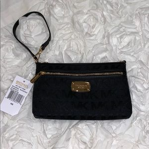 Brand new! Black Michael Kors wristlet!